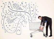 Affärsman med shoppingvagnen Royaltyfri Fotografi