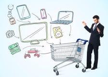 Affärsman med shoppingvagnen Arkivbilder