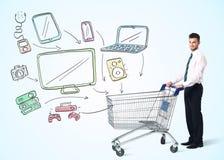 Affärsman med shoppingvagnen Royaltyfria Bilder
