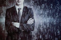 Affärsman med siffror arkivbild