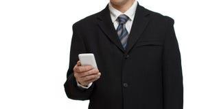 Affärsman med smartphonen Fotografering för Bildbyråer