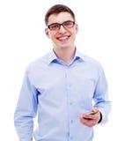 Affärsman med telefonen Arkivfoto
