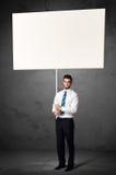 Affärsman med tom whiteboard Royaltyfri Fotografi