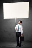 Affärsman med tom whiteboard Arkivfoton