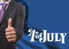 Affärsman med tummen upp för 4th juli Royaltyfria Foton