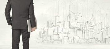 Affärsman med utdragen stadssikt Arkivbilder