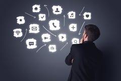 Affärsman med vita applikationer Arkivbild