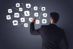 Affärsman med vita applikationer Royaltyfri Fotografi