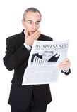 Affärsman With Newspaper Royaltyfria Bilder