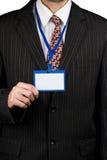 Affärsman och emblem arkivfoto