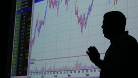 Affärsman och finansmarknadutbyte - graf arkivfilmer