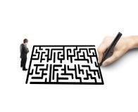 Affärsman och labyrint Arkivbilder