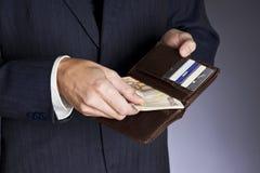 Affärsman och pengar royaltyfria bilder
