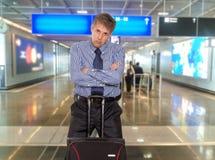 Affärsman på flygplatsen royaltyfri bild
