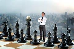 Affärsman på schackbrädet royaltyfria foton