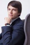Affärsman på stol över vit bakgrund Royaltyfria Bilder