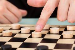 Affärsman Playing Checkers Arkivbild