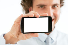 Affärsman Presenting Smart Phone royaltyfria foton