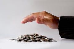 Affärsman Protecting Coins Arkivbilder