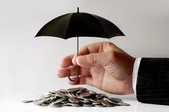 Affärsman Protecting Coins Fotografering för Bildbyråer