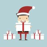 Affärsman Santa som rymmer en stor gåvaask Arkivbilder