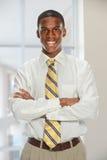 Affärsman Smiling Indide Office Arkivfoton