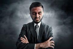 Affärsman som är ilsken på rökbakgrund Fotografering för Bildbyråer