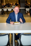 Affärsman som äter lunch Royaltyfri Bild