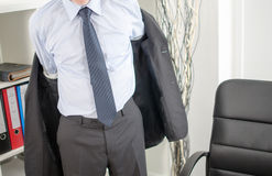 Affärsman som ankommer på kontoret Royaltyfria Bilder