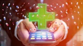Affärsman som använder en smartphone med ett belysningapotekkors Arkivfoton