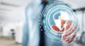 Affärsman som använder säkert skydd för sköld för att skydda hans data 3D Royaltyfri Bild