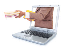 Affärsman som bär en bok och ut ur bärbara datorn Royaltyfri Bild