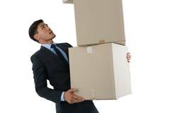 Affärsman som balanserar kartonger Arkivfoton