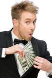 Affärsman som döljer dollar royaltyfri bild