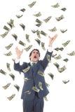 Affärsman som fångar fallande sedlar och att skrika för dollar Arkivbild