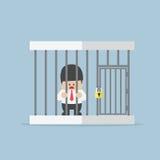 Affärsman som fångas i en bur Arkivbilder