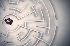 Affärsman som fångas i en rund labyrint Royaltyfria Foton