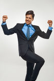 Affärsman som firar framgång mot vit bakgrund royaltyfri bild