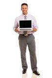 Affärsman som framlägger bärbara datorn arkivbilder