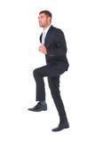 Affärsman som går med hans ben upp Royaltyfria Bilder