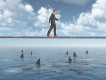 Affärsman som går på ett bräde över havet Royaltyfri Fotografi