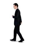 Affärsman som går sidan Arkivfoto