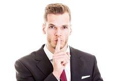 Affärsman som gör en gest för tystnad Royaltyfria Foton