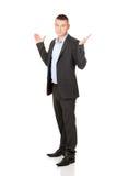 Affärsman som gör obeslutad gest Royaltyfria Foton