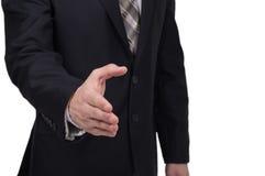 Affärsman som ger hans hand för handskakning till partnern Arkivfoton