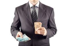 affärsman som ger pengar Royaltyfria Bilder