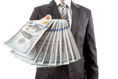 affärsman som ger pengar Arkivbild
