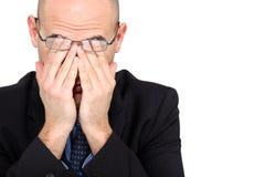 Affärsman som gnider hans ögon Arkivfoto