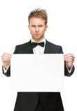 Affärsman som håller copyspace royaltyfri foto