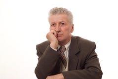 Affärsman som isoleras upp på white Arkivfoto